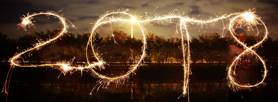 2018 spelled out in the sky at dusk using sparklers