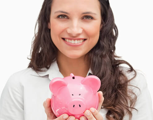 smiling woman holding a piggybank