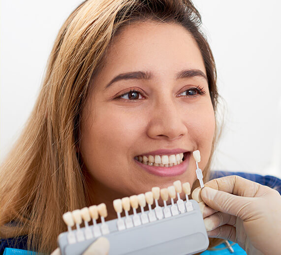 dental patient having veneers matched to her teeth