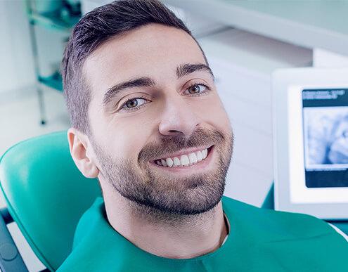 smiling man in dental chair