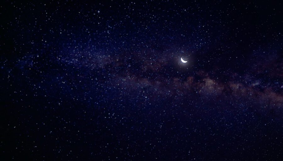 Looking up into the night sky with the moon and stars during your nighttime routine